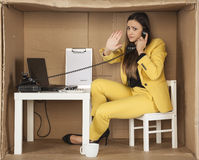 Businesswoman performs a gesture stop during a telephone conver Royalty Free Stock Photography