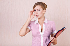 Businesswoman perplexed by problem of work Stock Images