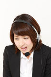 Businesswoman perplexed to a complaint telephone Royalty Free Stock Photo