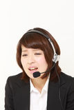 Businesswoman perplexed to a complaint telephone Stock Photos