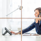 Businesswoman or personal assistant on a call Stock Photo