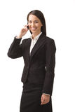 Businesswoman with a phone. Young, successful business woman with a cell phone isolated on a white background Stock Photos