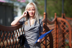 Businesswoman on the phone. Young blonde businesswoman on the phone Royalty Free Stock Photography