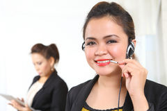 Businesswoman on phone. Beautiful ethnic businesswomen on telephone headset Stock Images