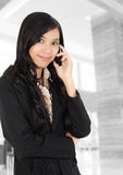 Businesswoman on the phone. Young Asian businesswoman on the phone at the office Royalty Free Stock Photos