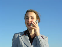Businesswoman with phone. On blue sky royalty free stock photos