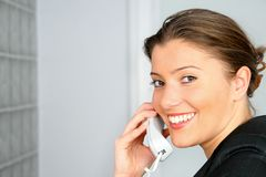 Businesswoman and phone Stock Images