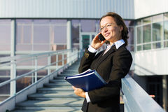 Business woman calling on the cell phone  Royalty Free Stock Photo