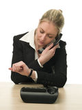 Businesswoman on a phone checking her watch Stock Images