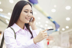 Businesswoman on the Phone, Checking the Ticket Royalty Free Stock Images