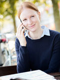 Businesswoman on the Phone in a City Park Stock Photography