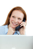 Businesswoman on phone at a computer Stock Photos
