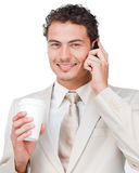 Businesswoman on phone drinking a coffee Royalty Free Stock Photos