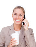 Businesswoman on phone and drinking a coffee Royalty Free Stock Photography