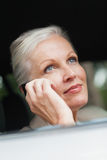 Businesswoman on the phone driving classy car Royalty Free Stock Photography