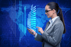 The businesswoman with phone in global business concept Royalty Free Stock Photo