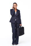 Businesswoman on phone going to work Stock Images