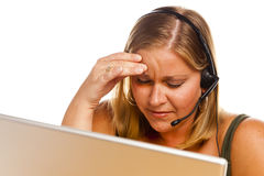 Businesswoman with Phone Headset and Headache Royalty Free Stock Images