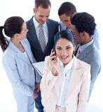 Businesswoman on phone and her team Royalty Free Stock Image