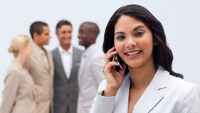 Businesswoman on phone with her team Royalty Free Stock Photography
