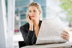 Businesswoman with Phone and Laptop Stock Photos