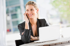 Businesswoman with Phone and Laptop Royalty Free Stock Photo