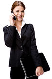 Businesswoman on phone with laptop Royalty Free Stock Image