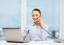 Businesswoman with phone, laptop and files Stock Images