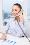 Businesswoman with phone, laptop and files Royalty Free Stock Images