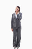 Businesswoman on the phone looking up Royalty Free Stock Photography