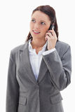 Businesswoman on the phone looking up Royalty Free Stock Image