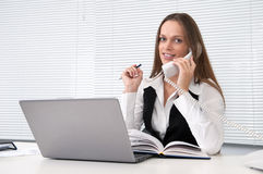 Businesswoman on phone looks into camera Royalty Free Stock Photography