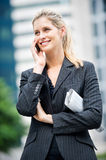 Businesswoman with Phone and Newspapers Stock Image