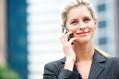 Businesswoman with Phone and Newspapers Royalty Free Stock Photography