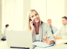 Businesswoman with phone in office Stock Photo