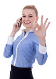 Businesswoman with phone and ok gesture Stock Photography