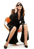 Businesswoman with phone in orange chair Stock Image