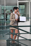 Businesswoman on the phone outside Royalty Free Stock Image