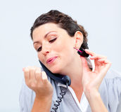 Businesswoman on phone painting her nails Royalty Free Stock Photos