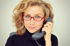 Businesswoman on the Phone. With red glasses royalty free stock photos