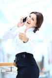 businesswoman on phone and showing tumbs up Royalty Free Stock Photo