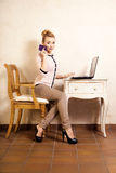 Businesswoman with phone touching screen laptop Stock Photos