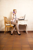 Businesswoman with phone touching screen laptop Stock Images