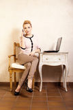 Businesswoman with phone touching screen laptop Stock Photo
