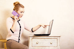 Businesswoman with phone touching screen laptop Royalty Free Stock Photography