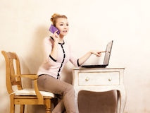 Businesswoman with phone touching screen laptop Royalty Free Stock Photos