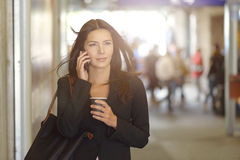 Businesswoman on Phone Walking In the Mall Stock Images