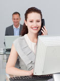 Businesswoman on phone and working in the office Royalty Free Stock Photo