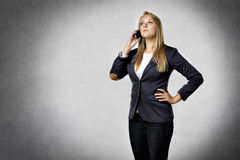 Businesswoman phoned mobile Royalty Free Stock Image
