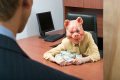 Businesswoman in pig mask holding money Royalty Free Stock Photos